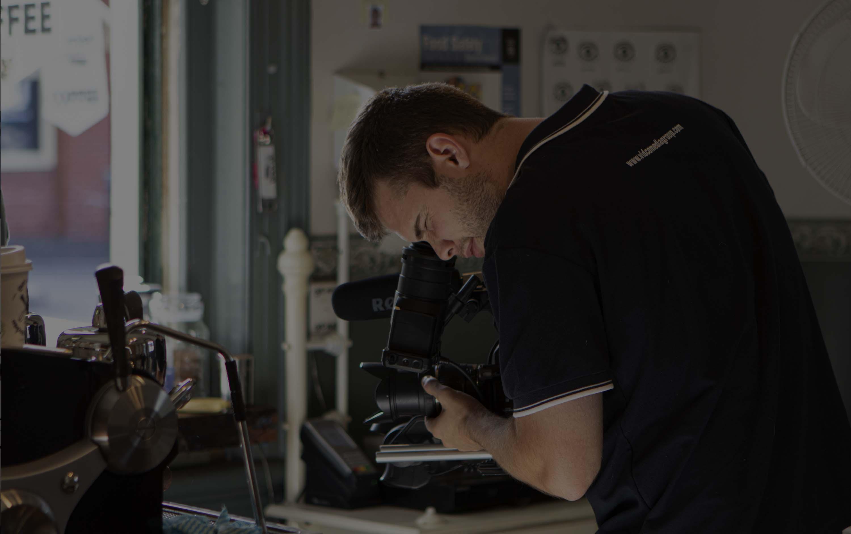 videographer looking through camera at video production set in Bendigo cafe
